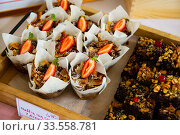 Купить «Muffins with strawberry», фото № 33558781, снято 15 июля 2020 г. (c) Яков Филимонов / Фотобанк Лори