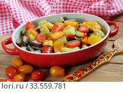 Купить «Vegetable stew with eggplant and zucchini on a wooden background», фото № 33559781, снято 15 апреля 2020 г. (c) Марина Володько / Фотобанк Лори