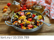 Купить «Vegetable stew with eggplant and zucchini on a wooden background», фото № 33559789, снято 15 апреля 2020 г. (c) Марина Володько / Фотобанк Лори