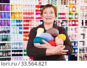 Купить «Woman in needlework shop», фото № 33564821, снято 10 мая 2017 г. (c) Яков Филимонов / Фотобанк Лори