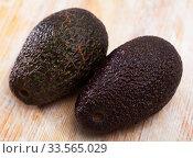 Купить «Image of ripe avocado at table, healthy food», фото № 33565029, снято 11 июля 2020 г. (c) Яков Филимонов / Фотобанк Лори