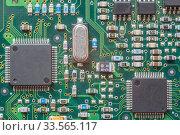 Купить «Chips on a printed board», фото № 33565117, снято 24 февраля 2019 г. (c) Дмитрий Тищенко / Фотобанк Лори