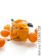 Купить «tangerine jam in a glass jar isolated on white background», фото № 33565729, снято 16 апреля 2020 г. (c) Peredniankina / Фотобанк Лори