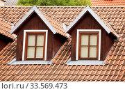 Купить «Roof with red tiling and two dormer windows», фото № 33569473, снято 13 июля 2020 г. (c) easy Fotostock / Фотобанк Лори