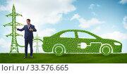 Купить «Electric car and green energy concept», фото № 33576665, снято 10 июля 2020 г. (c) Elnur / Фотобанк Лори