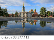 Tula, Russia, June 30, 2016. Beautiful cityscape with a view of the Tula Kremlin on a summer day and with reflection in puddles after rain. Редакционное фото, фотограф Яна Королёва / Фотобанк Лори