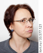 Купить «Portrait of a sad woman with glasses and short hair on a white background», фото № 33577121, снято 15 января 2018 г. (c) Элина Гаревская / Фотобанк Лори