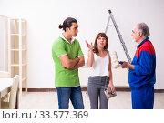 Купить «Young couple and old contractor in home renovation concept», фото № 33577369, снято 2 сентября 2019 г. (c) Elnur / Фотобанк Лори