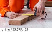 Купить «Contractor working on laminate wooden floor», фото № 33579433, снято 14 декабря 2017 г. (c) Elnur / Фотобанк Лори