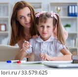 Купить «Mother helping her daughter to do homework», фото № 33579625, снято 21 июня 2017 г. (c) Elnur / Фотобанк Лори