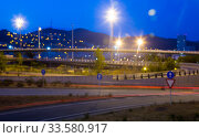 Купить «Blurred view of illuminated city road in evening», фото № 33580917, снято 20 июля 2017 г. (c) Яков Филимонов / Фотобанк Лори