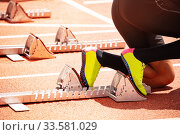 Купить «Shoes and start track before sprint run on stadium», фото № 33581029, снято 15 июня 2018 г. (c) Сергей Новиков / Фотобанк Лори
