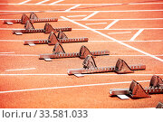Купить «Starting blocks for stadium running sprint tracks», фото № 33581033, снято 15 июня 2018 г. (c) Сергей Новиков / Фотобанк Лори