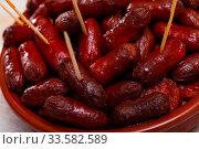 Купить «Spanish appetizer, warm mini chorizo sausages», фото № 33582589, снято 24 мая 2020 г. (c) Яков Филимонов / Фотобанк Лори