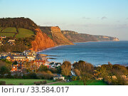 Sidmouth and the red sandstone cliffs of the Jurassic Coast World Heritage Site, Devon, England, UK, October 2009. Стоковое фото, фотограф Guy Edwardes / Nature Picture Library / Фотобанк Лори