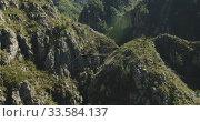 Купить «Landscape with zip line stretched across mountains», видеоролик № 33584137, снято 20 августа 2019 г. (c) Wavebreak Media / Фотобанк Лори