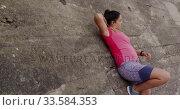 Купить «Caucasian woman resting on a wall», видеоролик № 33584353, снято 9 апреля 2019 г. (c) Wavebreak Media / Фотобанк Лори