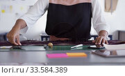 Купить «Mixed race woman taking measure in fashion office», видеоролик № 33584389, снято 10 апреля 2019 г. (c) Wavebreak Media / Фотобанк Лори
