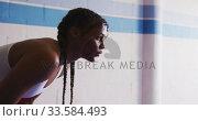 Купить «Mixed race woman resting in boxing gym», видеоролик № 33584493, снято 15 мая 2019 г. (c) Wavebreak Media / Фотобанк Лори