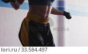 Купить «Mixed race woman working out in boxing gym», видеоролик № 33584497, снято 15 мая 2019 г. (c) Wavebreak Media / Фотобанк Лори