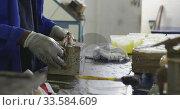 Mixed race man working in factory. Стоковое видео, агентство Wavebreak Media / Фотобанк Лори