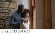 Couple looking through the windows at home. Стоковое видео, агентство Wavebreak Media / Фотобанк Лори