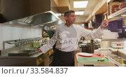 Купить «Caucasian man cooking in the kitchen», видеоролик № 33584837, снято 11 апреля 2019 г. (c) Wavebreak Media / Фотобанк Лори