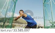 Mixed race athlete doing discus throw. Стоковое видео, агентство Wavebreak Media / Фотобанк Лори