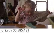 Купить «Caucasian woman undressing baby at home», видеоролик № 33585181, снято 12 апреля 2019 г. (c) Wavebreak Media / Фотобанк Лори