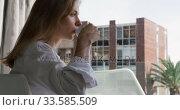 Side view of caucasian woman drinking coffee in hotel. Стоковое видео, агентство Wavebreak Media / Фотобанк Лори