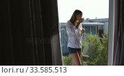 Caucasian woman drinking coffee in hotel room. Стоковое видео, агентство Wavebreak Media / Фотобанк Лори