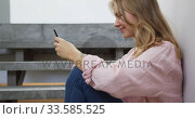 Купить «Side view of woman using smartphone in hotel», видеоролик № 33585525, снято 13 мая 2019 г. (c) Wavebreak Media / Фотобанк Лори
