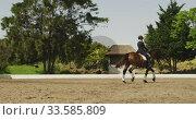 Caucasian woman riding her horse. Стоковое видео, агентство Wavebreak Media / Фотобанк Лори