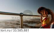 Купить «Mother and son pointing away the sea», видеоролик № 33585881, снято 14 июня 2019 г. (c) Wavebreak Media / Фотобанк Лори