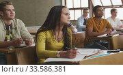 Купить «Students concentrating in high school class», видеоролик № 33586381, снято 18 сентября 2019 г. (c) Wavebreak Media / Фотобанк Лори