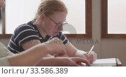 Students writing in high school class. Стоковое видео, агентство Wavebreak Media / Фотобанк Лори