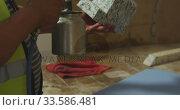 Worker washing a piece of concrete block. Стоковое видео, агентство Wavebreak Media / Фотобанк Лори