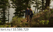 Active senior couple taking picture in forest. Стоковое видео, агентство Wavebreak Media / Фотобанк Лори