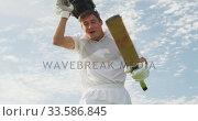 Low angle view cricket player taking off his helmet. Стоковое видео, агентство Wavebreak Media / Фотобанк Лори
