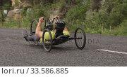 Купить «Disabled man riding a recumbent bicycle», видеоролик № 33586885, снято 16 апреля 2019 г. (c) Wavebreak Media / Фотобанк Лори