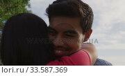 Купить «Young couple in love hugging», видеоролик № 33587369, снято 30 мая 2019 г. (c) Wavebreak Media / Фотобанк Лори