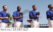 Купить «Baseball players standing on line», видеоролик № 33587621, снято 25 ноября 2019 г. (c) Wavebreak Media / Фотобанк Лори