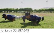 Купить «Baseball players making push ups», видеоролик № 33587649, снято 25 ноября 2019 г. (c) Wavebreak Media / Фотобанк Лори