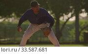 Baseball player catching a ball during a match. Стоковое видео, агентство Wavebreak Media / Фотобанк Лори