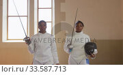 Купить «Female fencer athletes during a fencing training in a gym», видеоролик № 33587713, снято 16 ноября 2019 г. (c) Wavebreak Media / Фотобанк Лори