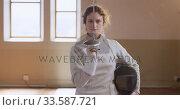 Купить «Female fencer athlete during a fencing training in a gym», видеоролик № 33587721, снято 16 ноября 2019 г. (c) Wavebreak Media / Фотобанк Лори