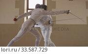 Купить «Fencer athletes during a fencing training in a gym», видеоролик № 33587729, снято 16 ноября 2019 г. (c) Wavebreak Media / Фотобанк Лори