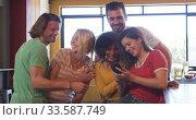 Friends at the bar in a pub taking a selfie. Стоковое видео, агентство Wavebreak Media / Фотобанк Лори
