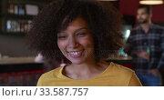 Купить «Woman looking at camera and smiling», видеоролик № 33587757, снято 15 ноября 2019 г. (c) Wavebreak Media / Фотобанк Лори