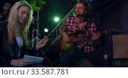 Купить «Female musician rehearsing before performing», видеоролик № 33587781, снято 15 ноября 2019 г. (c) Wavebreak Media / Фотобанк Лори